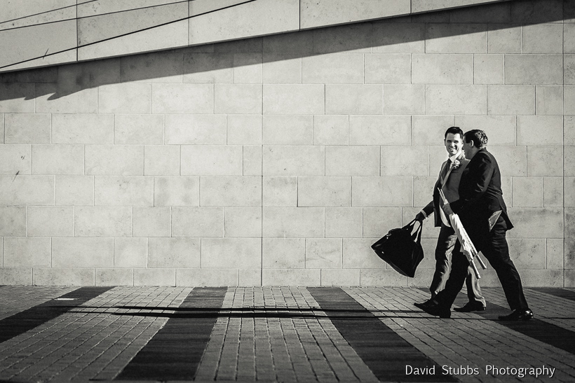 black and white men walking mersey