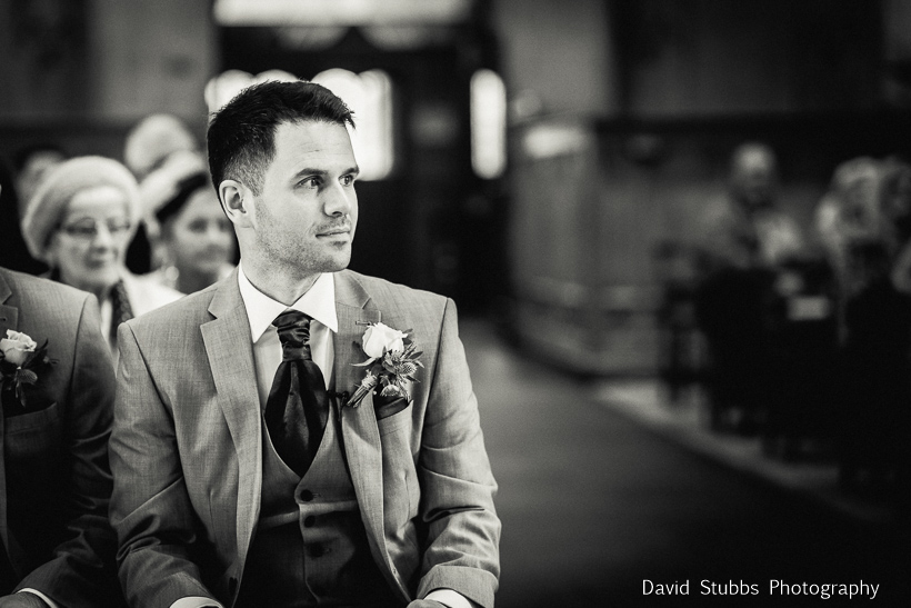 man sat in church waiting for bride