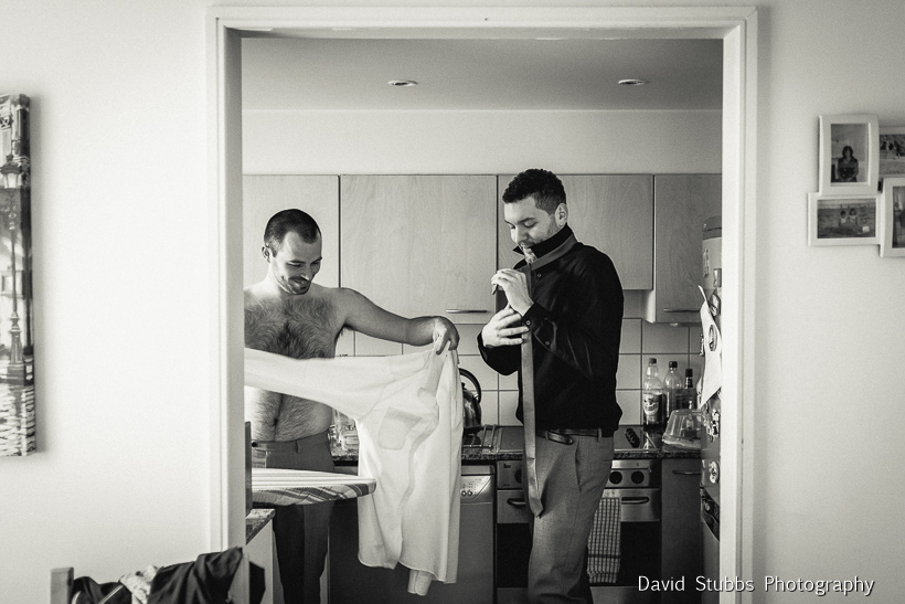 men getting dressed for wedding