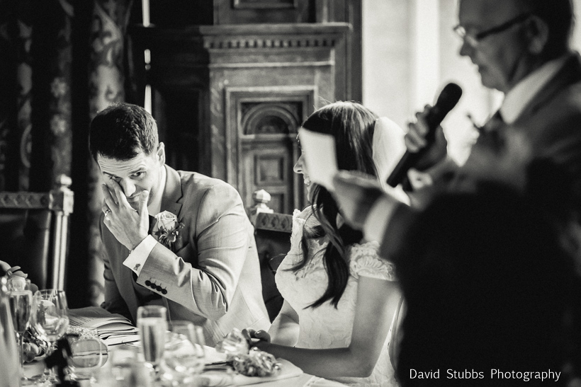 bride and groom reacting to speech