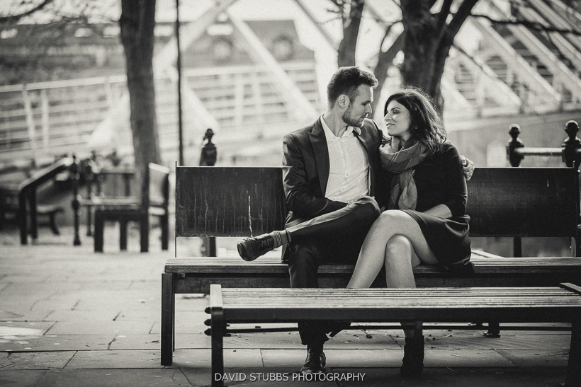 husband and wife to be on bench photography