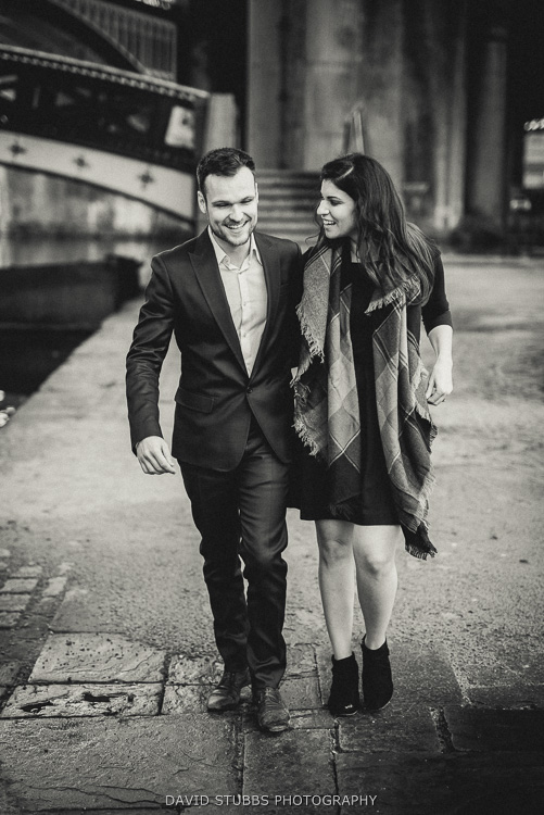 man and fiancée walking by canal