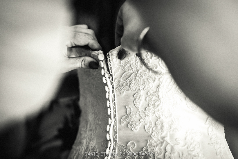 wedding dress being fasted