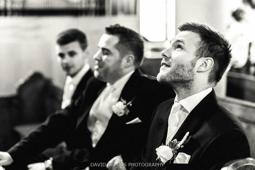 groom waiting in pew