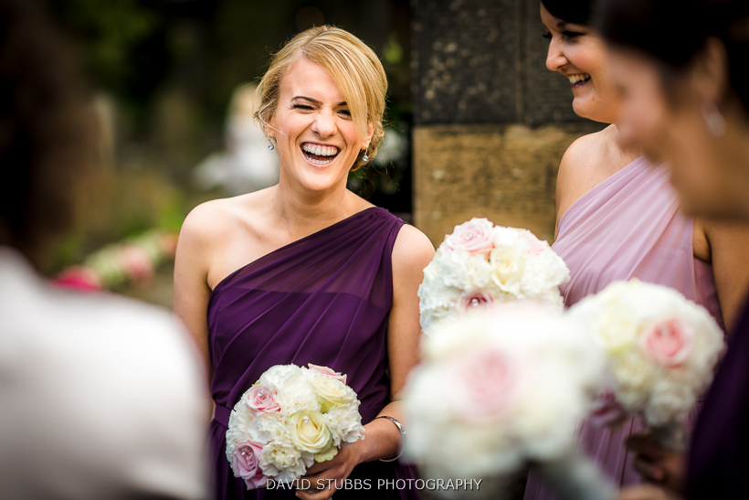 bridesmaids laughing outside church