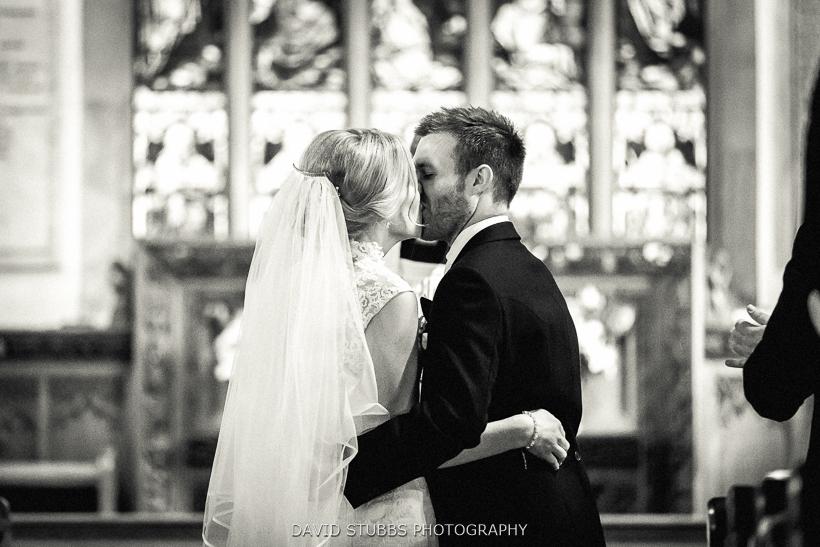 man kisses new wife