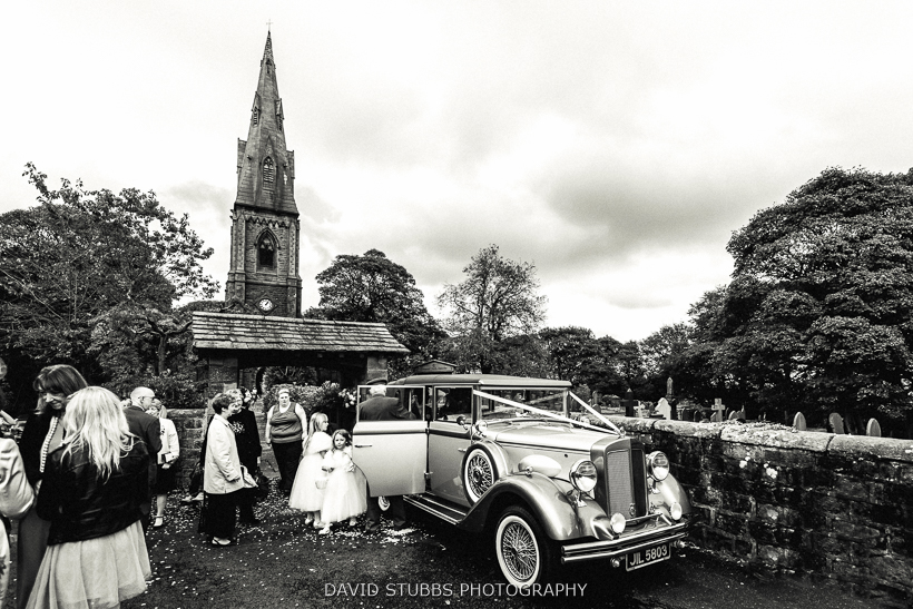 wedding car outside church black and white