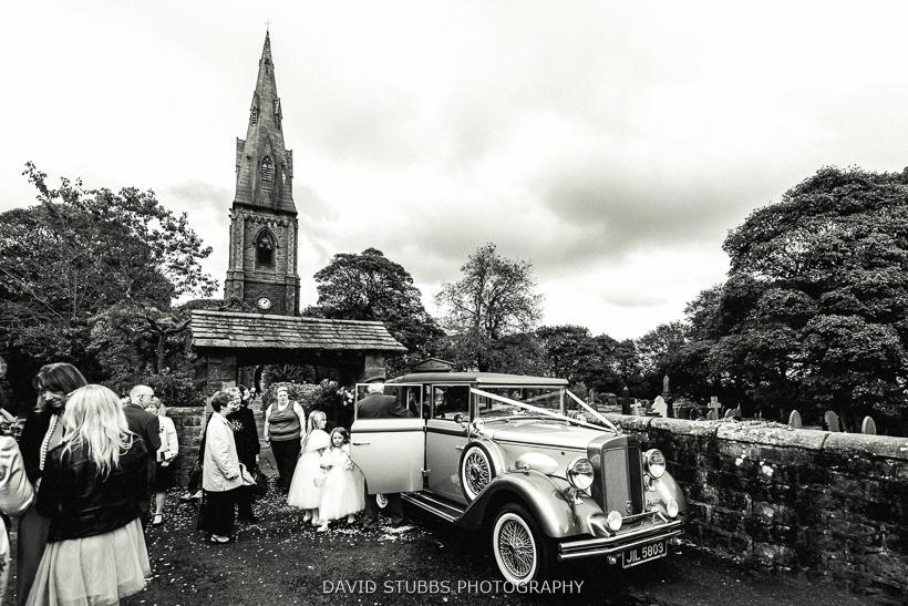 wedding car outside church black and white