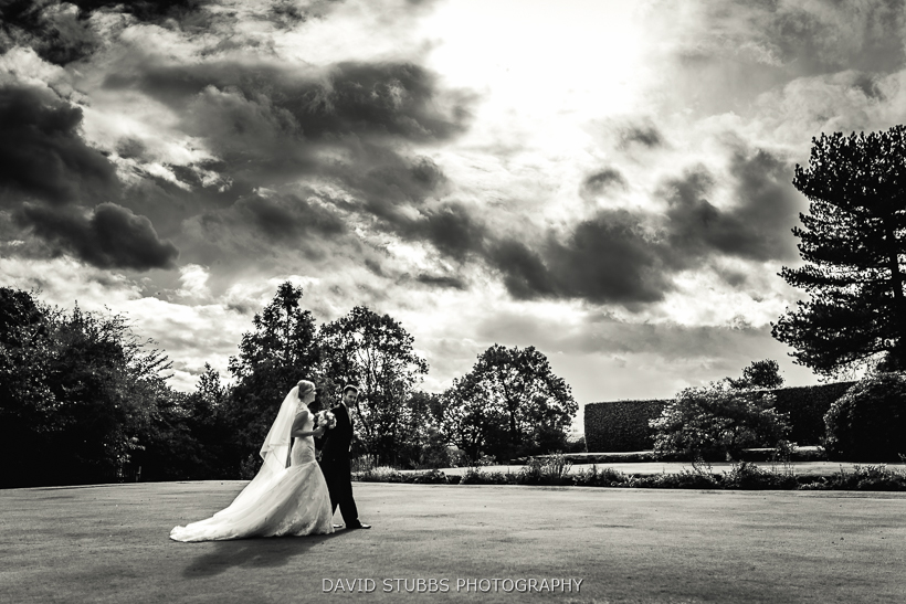 husband and wife walking across lawn