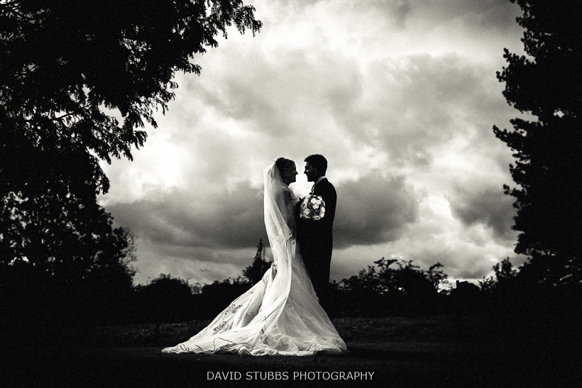silhouette of couple against clouds