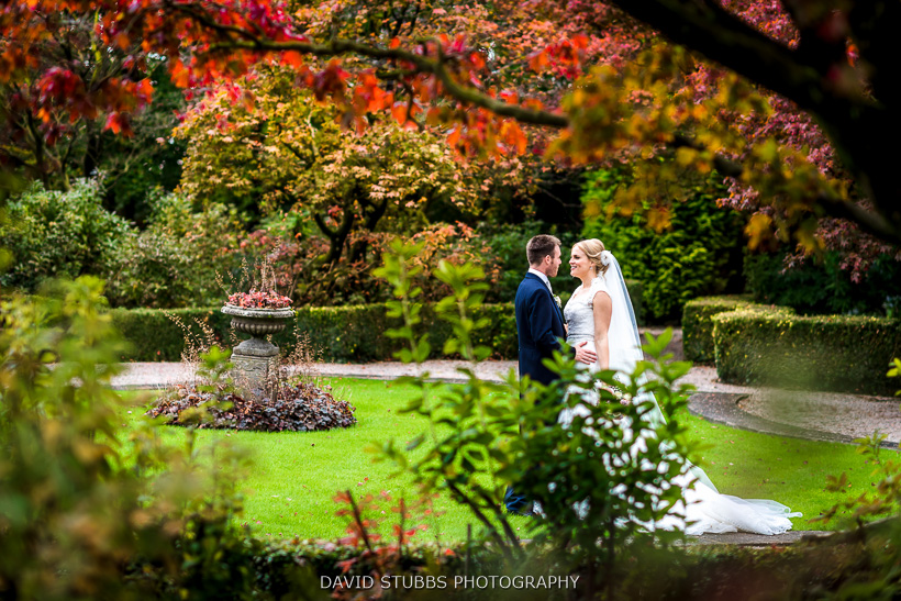 husband and wife through trees