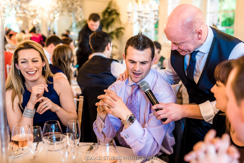 wedding singer and guests singing