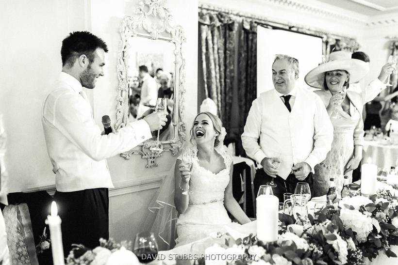groom toasting the bride