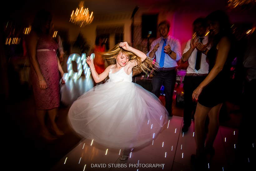 girl spinning around at wedding disco