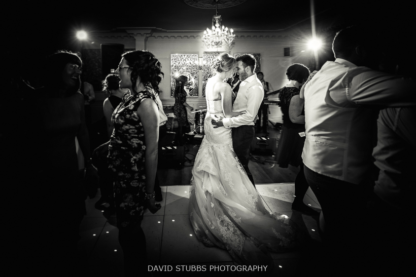 black and white photo of newly married couple dancing