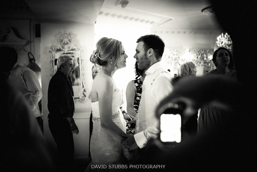 black and white photo of married man and woman at wedding disco
