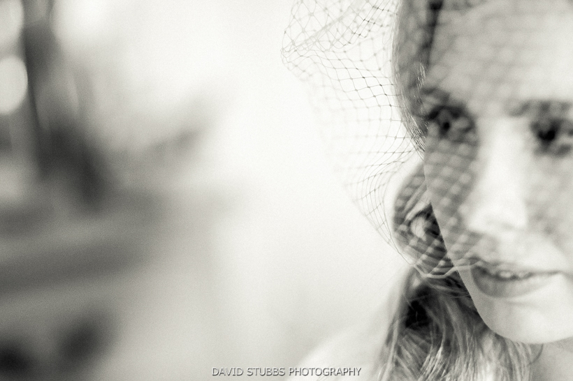 black and white photo of bride in veil