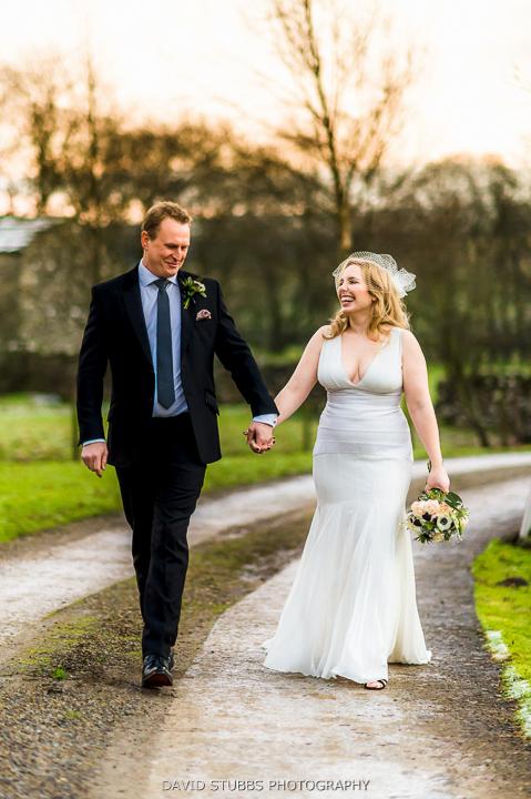 married couple walk in gardens