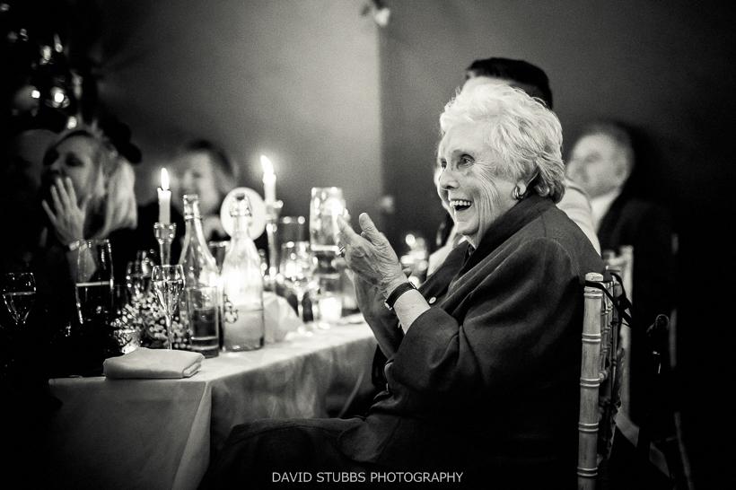woman applauding wedding speeches