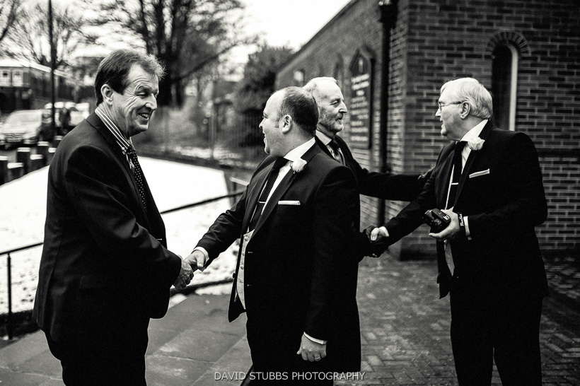 best man greeting guests