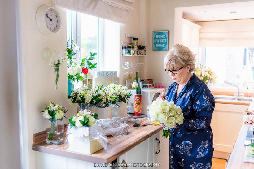 brides mother preparing flowers