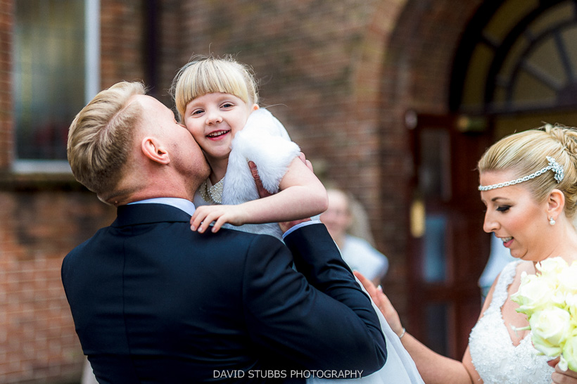 groom kissing bridesmaid
