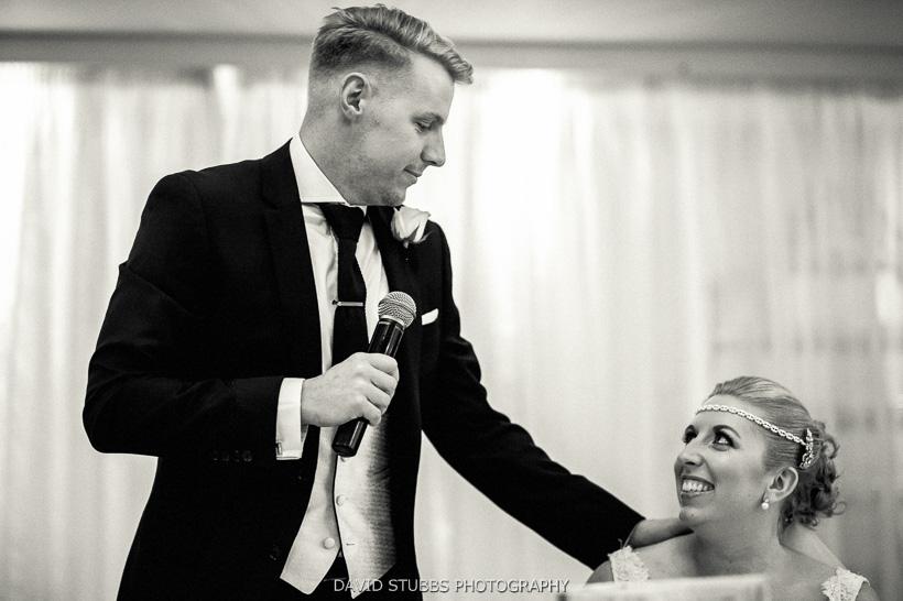 groom talking to bride
