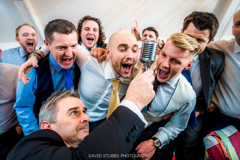 groom singing into microphone