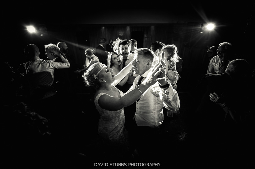 black and white photo of newly-weds dancing