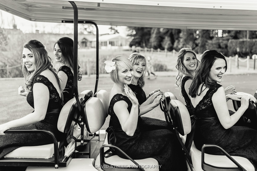 women on golf cart