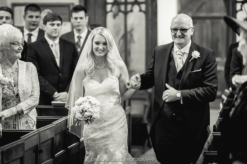 bride and father going up aisle
