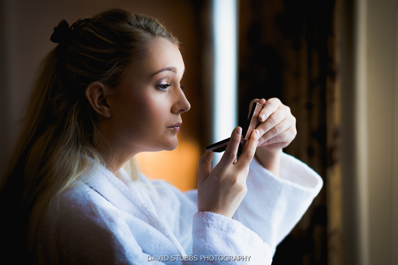 bride doing make up