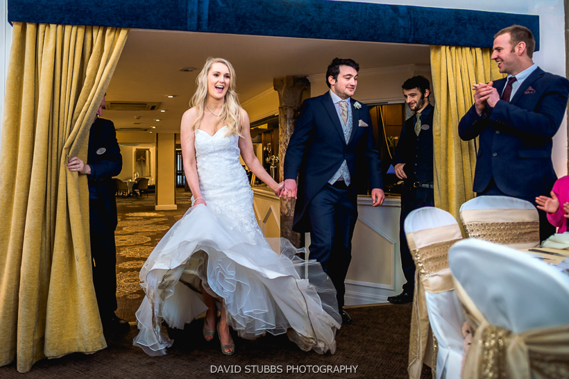 bride and groom arrive at party