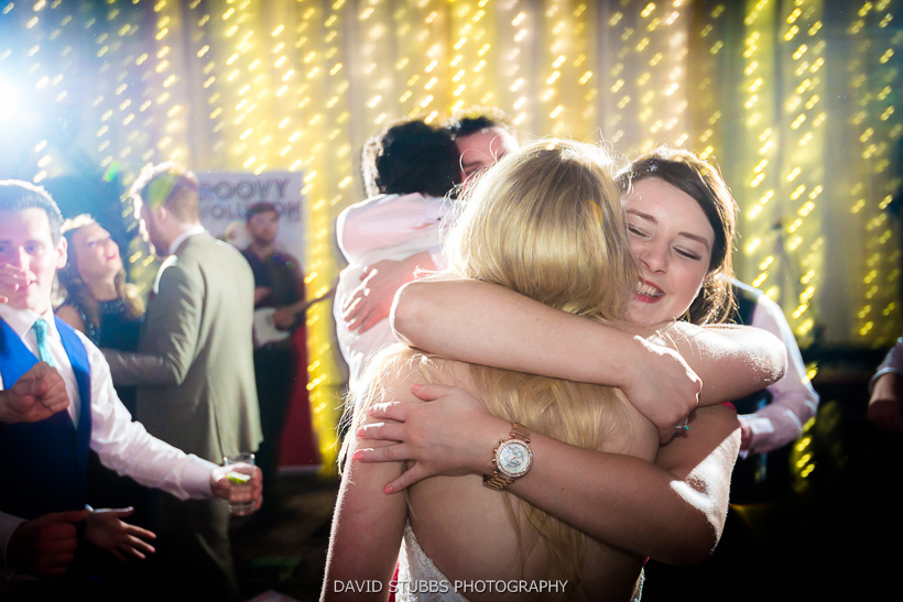 bride hugging friends