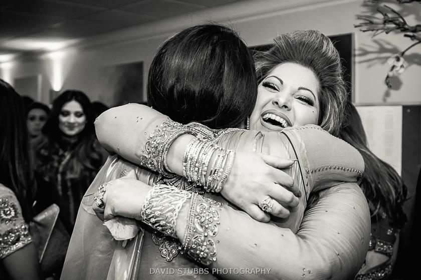 women hugging black and white photo