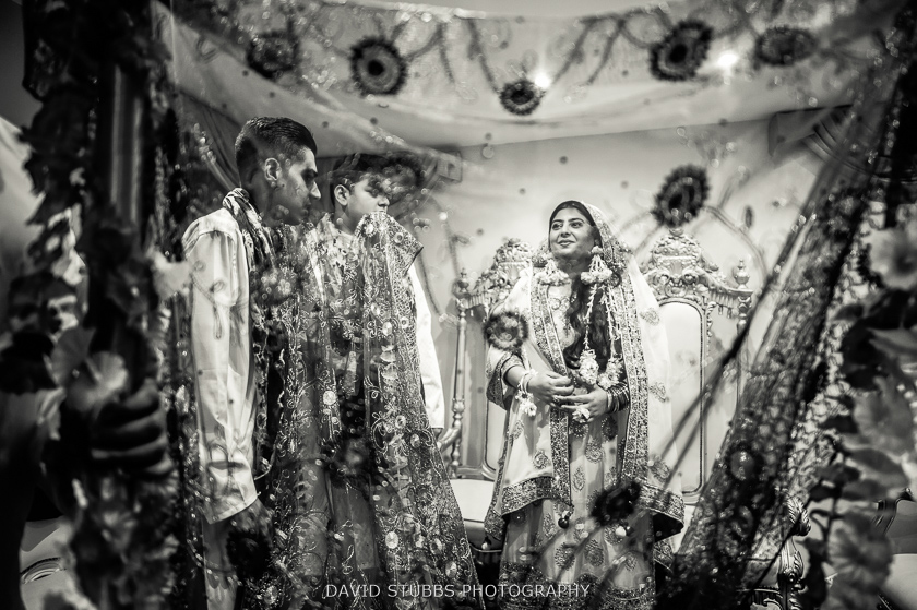 black and white photo of bride and men