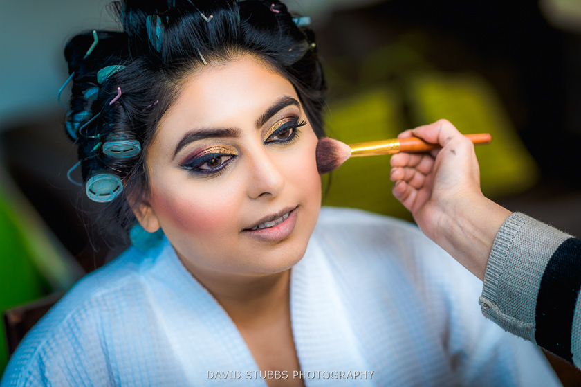 woman having make up done