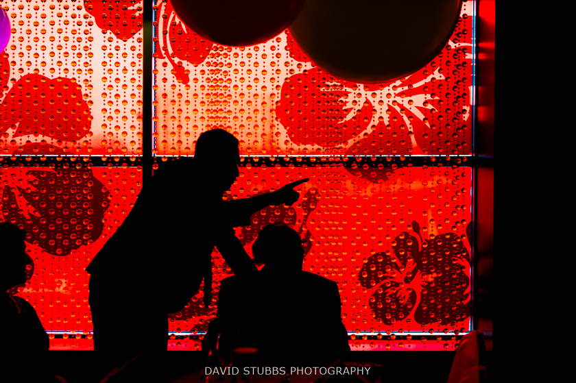 silhouette against red window