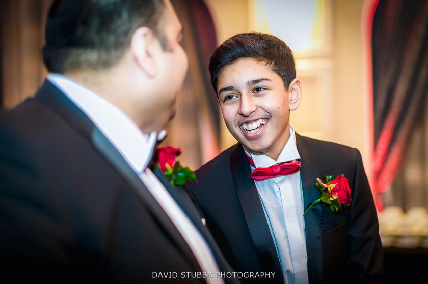 boy smiling at wedding