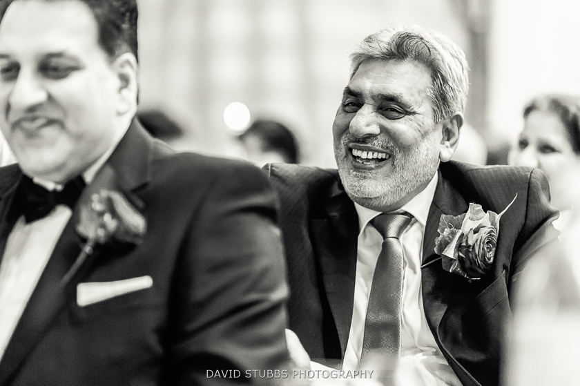 men laughing at speeches