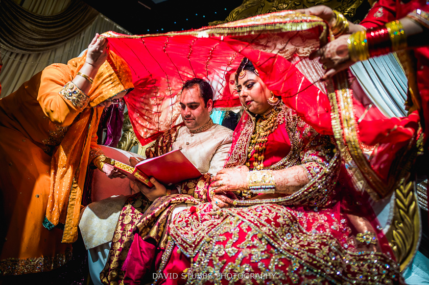 man and bride red sheet