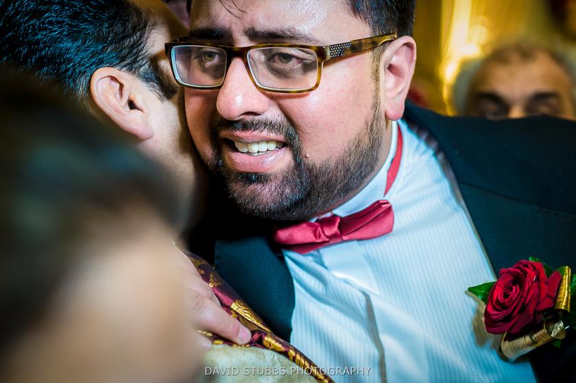 man crying at wedding