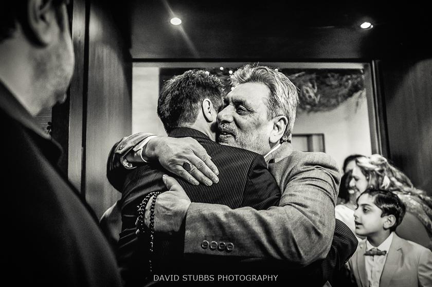 men hug black and white