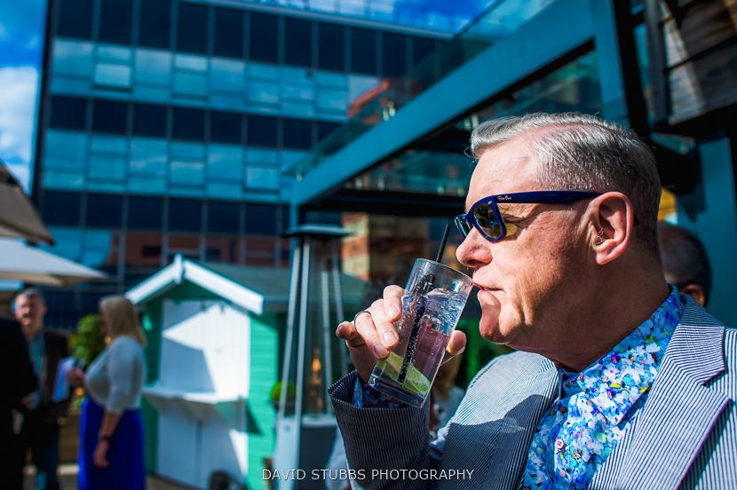 man drinking outside great john street