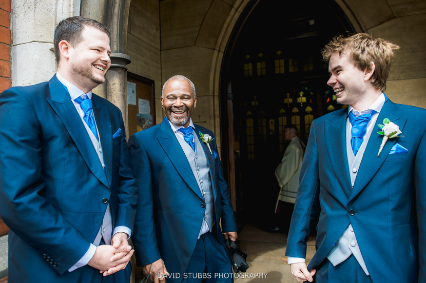 men laughing before ceremony