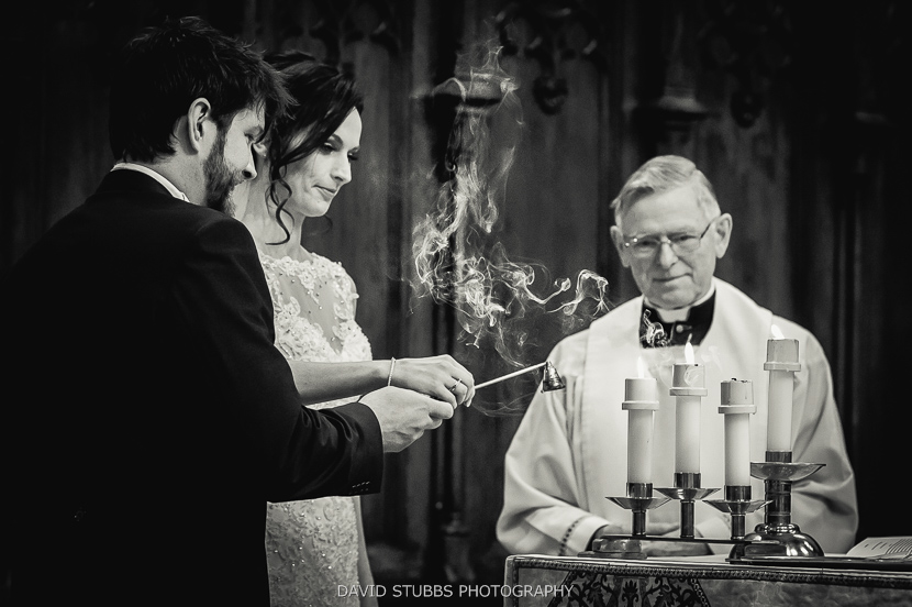 couple lighting candles