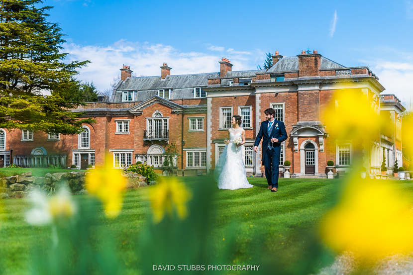 bride and husband walking on lawn