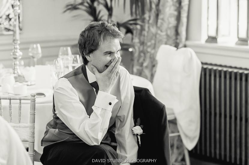man laughing at slideshow