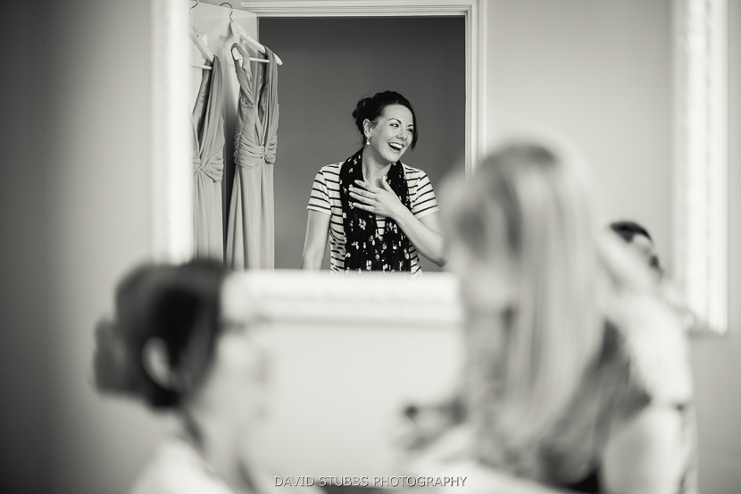 woman in mirror laughing