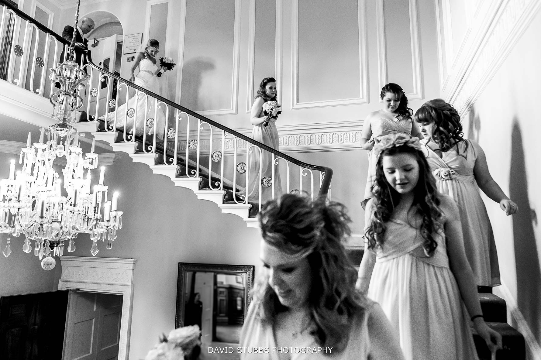 bride walkibng down the stairs at staircase